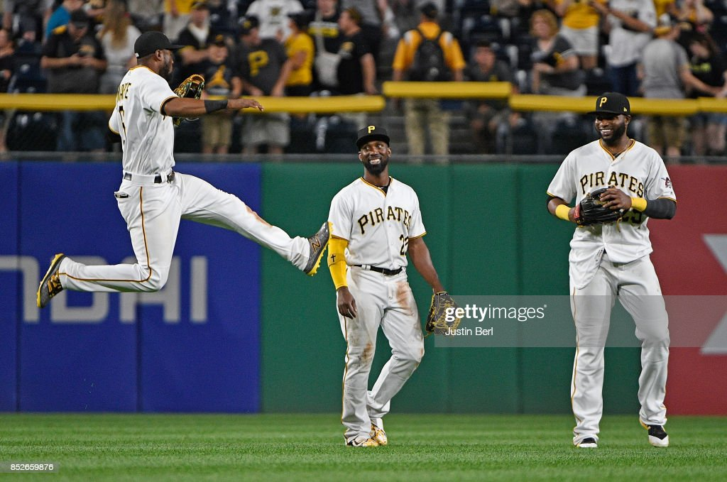 Starling Marte #6 of the Pittsburgh Pirates celebrates with Andrew McCutchen #22 and Gregory Polanco #25 after the final out in the Pittsburgh Pirates 11-6 win over the St. Louis Cardinals at PNC Park on September 23, 2017 in Pittsburgh, Pennsylvania.