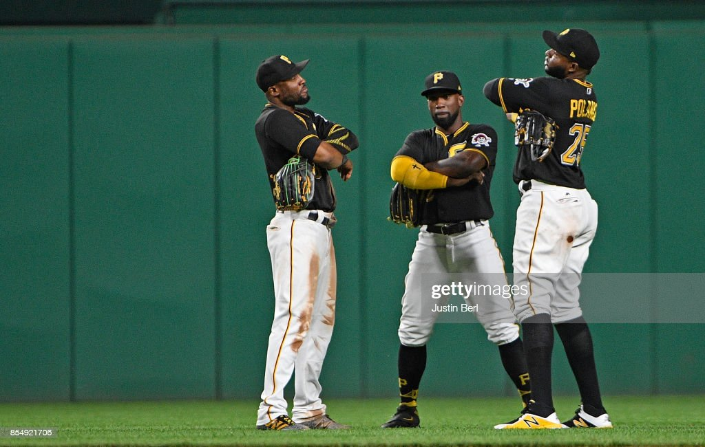 Starling Marte #6 of the Pittsburgh Pirates celebrates with Andrew McCutchen #22 and Gregory Polanco #25 after the final out in the Pittsburgh Pirates 5-3 win over the Baltimore Orioles at PNC Park on September 27, 2017 in Pittsburgh, Pennsylvania.