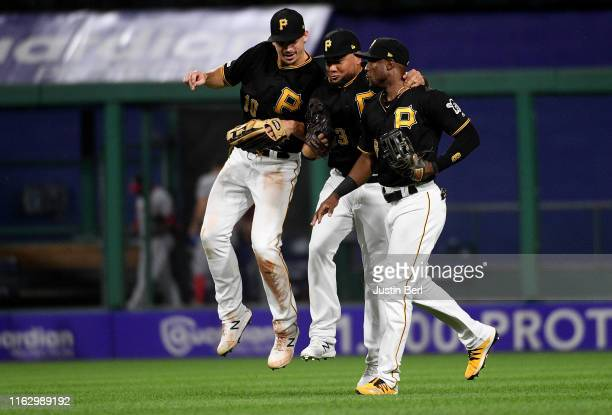 Starling Marte of the Pittsburgh Pirates celebrates with Bryan Reynolds and Melky Cabrera after the final out in a 4-1 win over the Washington...