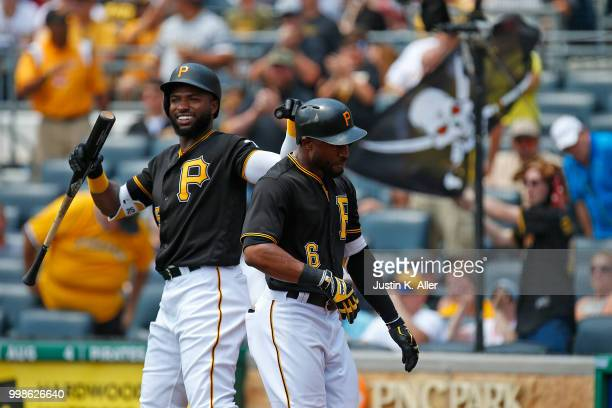 Starling Marte of the Pittsburgh Pirates celebrates with Gregory Polanco of the Pittsburgh Pirates after hitting a home run in the first inning...