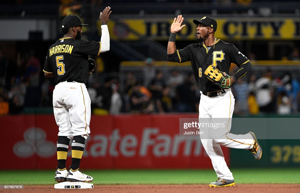 Starling Marte #6 of the Pittsburgh Pirates celebrates with Josh Harrison #5 after the final out in their 6-3 win over the Detroit Tigers at PNC Park on August 8, 2017 in Pittsburgh, Pennsylvania.