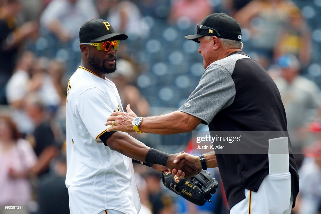 Starling Marte #6 of the Pittsburgh Pirates celebrates with manager Clint Hurdle #13 of the Pittsburgh Pirates after defeating the Washington Nationals 2-0 at PNC Park on July 11, 2018 in Pittsburgh, Pennsylvania.