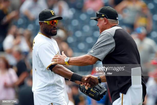 Starling Marte of the Pittsburgh Pirates celebrates with manager Clint Hurdle of the Pittsburgh Pirates after defeating the Washington Nationals 20...
