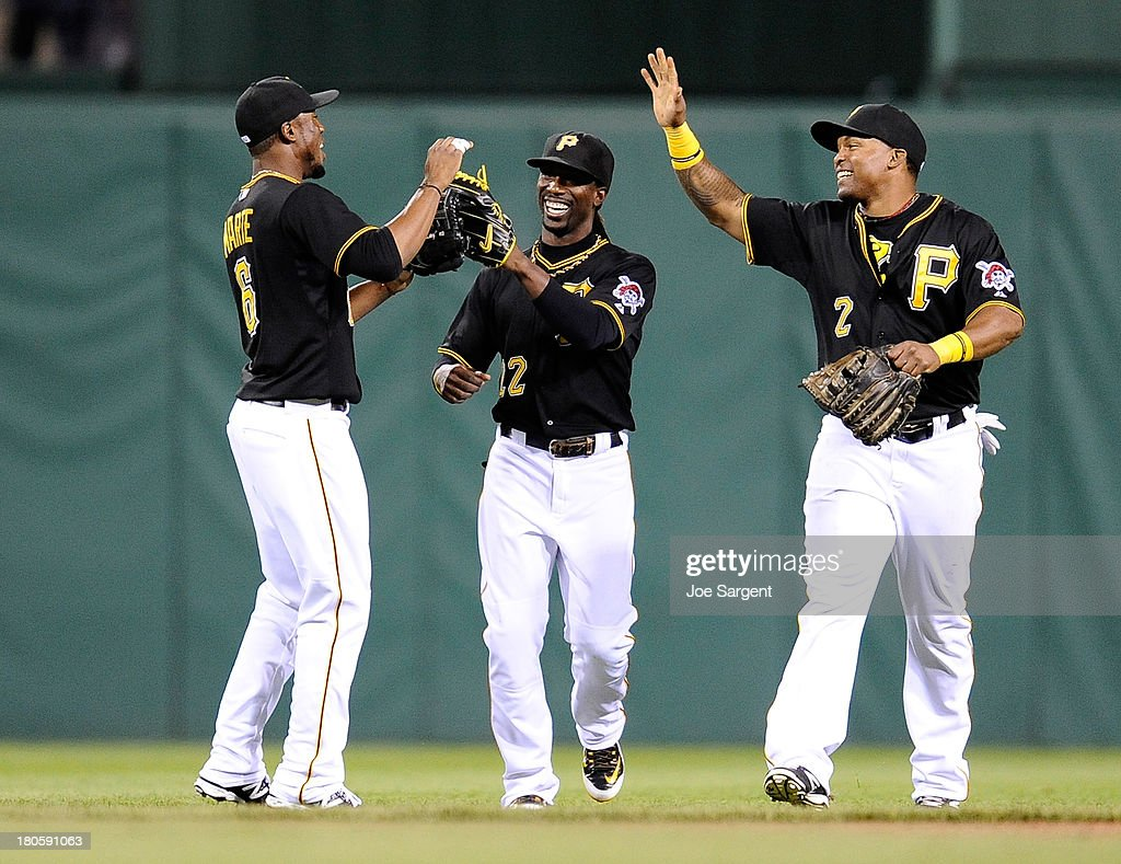 Starling Marte #6 of the Pittsburgh Pirates celebrates with teammates Andrew McCutchen #22 and Marlon Byrd #2 after a 2-1 win over the Chicago Cubs on September 14, 2013 at PNC Park in Pittsburgh, Pennsylvania.