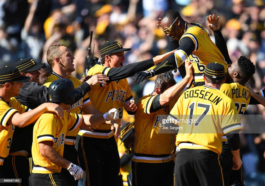 Starling Marte #6 of the Pittsburgh Pirates celebrates with teammates after hitting a two run home run during the tenth inning against the Atlanta Braves at PNC Park on April 9, 2017 in Pittsburgh, Pennsylvania. Pittsburgh won the game 6-5.