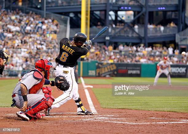 Starling Marte of the Pittsburgh Pirates hits a RBI single in the third inning during the game against the St Louis Cardinals at PNC Park on May 8...