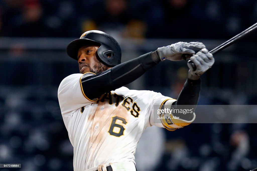 Starling Marte #6 of the Pittsburgh Pirates hits a triple in the sixth inning against the Colorado Rockies at PNC Park on April 16, 2018 in Pittsburgh, Pennsylvania.