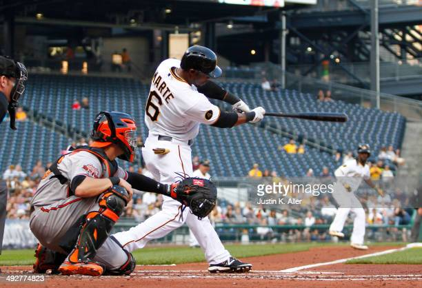 Starling Marte of the Pittsburgh Pirates hits a twoRBI triple in the first inning against the Baltimore Orioles during interleague play at PNC Park...