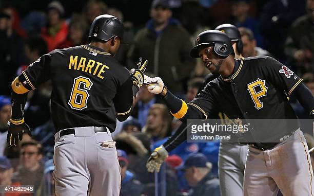 Starling Marte of the Pittsburgh Pirates is greeted by Andrew McCutchen after hitting a two run home run in the 4th inning against the Chicago Cubs...