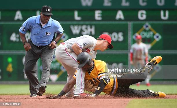Starling Marte of the Pittsburgh Pirates is tagged out at second base by Scott Kingery of the Philadelphia Phillies in the sixth inning during the...