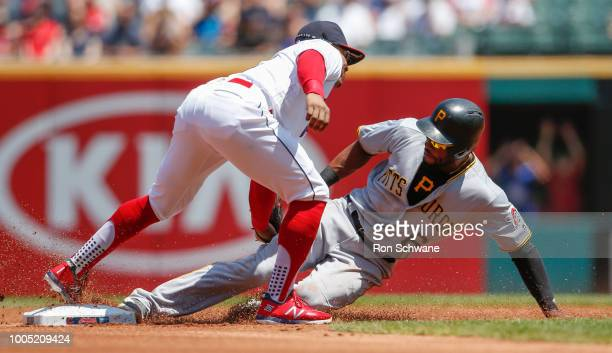 Starling Marte of the Pittsburgh Pirates is tagged out by Francisco Lindor of the Cleveland Indians attempting to steal second base during the first...
