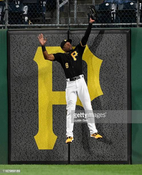 Starling Marte of the Pittsburgh Pirates makes a catch at the wall on a ball off the bat of Howie Kendrick of the Washington Nationals for the final...