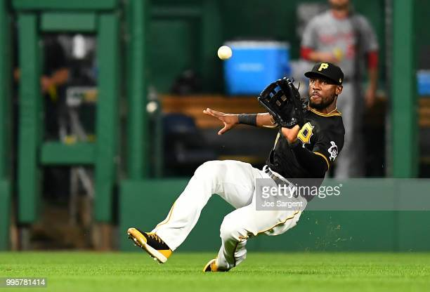 Starling Marte of the Pittsburgh Pirates makes a catch on a ball off the bat of Anthony Rendon of the Washington Nationals during the eighth inning...