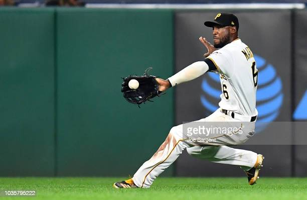 Starling Marte of the Pittsburgh Pirates makes a diving catch on a ball hit by Meibrys Viloria of the Kansas City Royals during the tenth inning at...