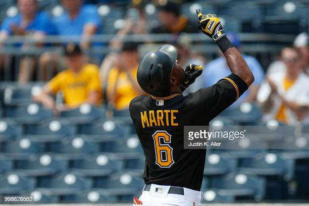 Starling Marte of the Pittsburgh Pirates reacts after hitting a home run in the first inning during game one of a doubleheader against the Milwaukee...