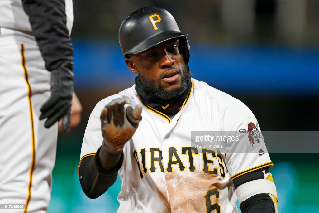 Starling Marte #6 of the Pittsburgh Pirates reacts after hitting a triple in the sixth inning against the Colorado Rockies at PNC Park on April 16, 2018 in Pittsburgh, Pennsylvania.