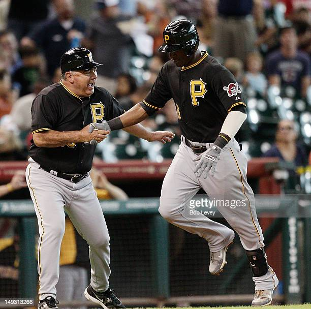 Starling Marte of the Pittsburgh Pirates receives congratulations from third base coach Nick Leyva of the Pittsburgh Pirates after hitting a home run...
