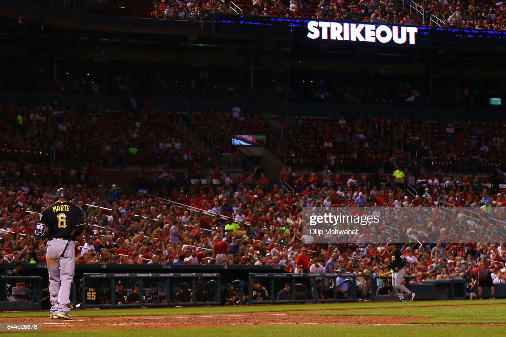 Starling Marte #6 of the Pittsburgh Pirates returns to the dugout after striking out against the St. Louis Cardinals in the seventh inning at Busch Stadium on September 8, 2017 in St. Louis, Missouri.