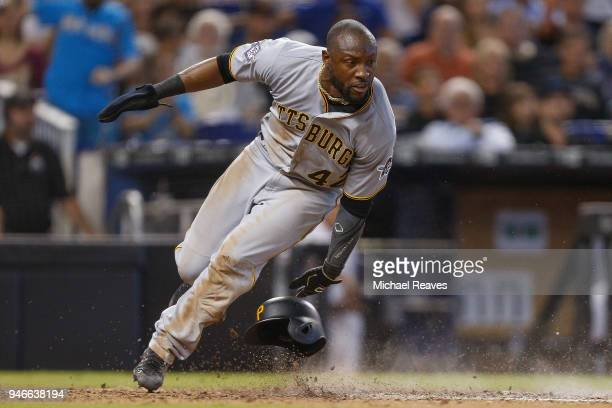 Starling Marte of the Pittsburgh Pirates scores a run in the seventh inning against the Miami Marlins at Marlins Park on April 15 2018 in Miami...