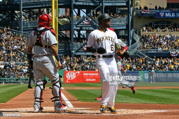 Starling Marte of the Pittsburgh Pirates scores on a two RBI double in the first inning against the St. Louis Cardinals at the home opener at PNC...