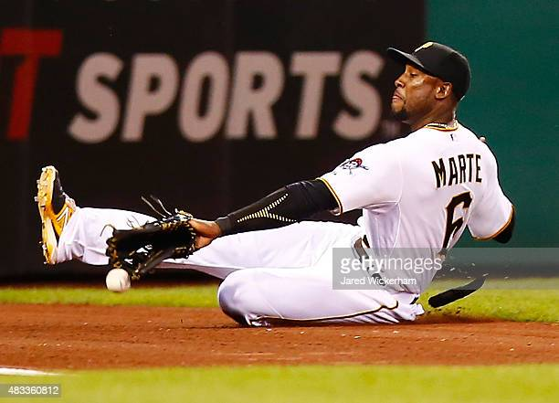 Starling Marte of the Pittsburgh Pirates slides but comes up short on a catch in left field against the Los Angeles Dodgers during the game at PNC...