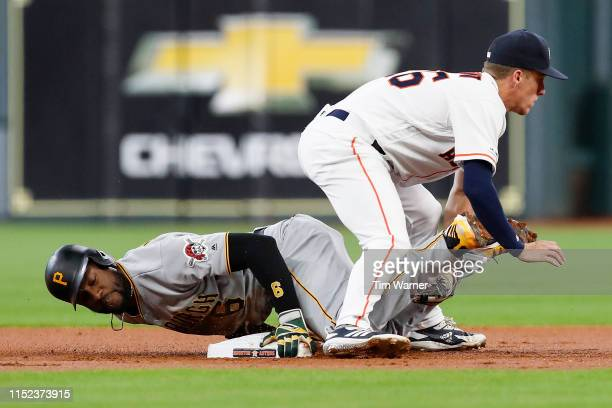 Starling Marte of the Pittsburgh Pirates steals second base as Myles Straw of the Houston Astros cannot field the throw in the first inning at Minute...