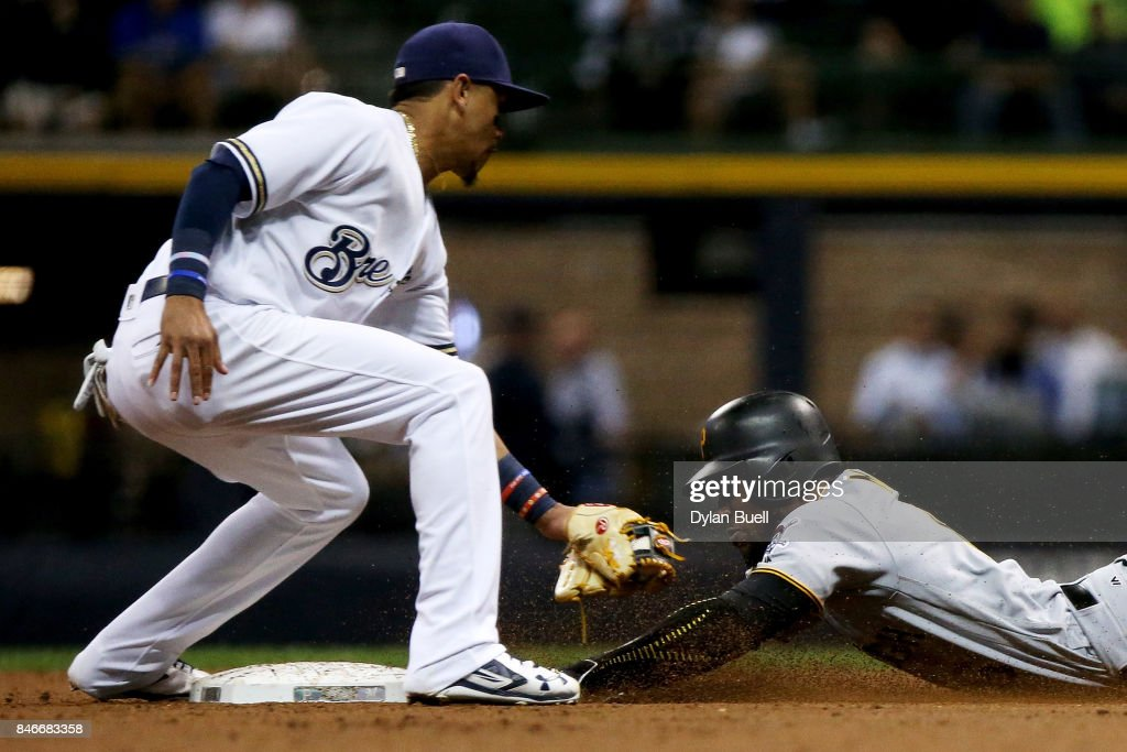 Starling Marte #6 of the Pittsburgh Pirates steals second base past Orlando Arcia #3 of the Milwaukee Brewers in the third inning at Miller Park on September 13, 2017 in Milwaukee, Wisconsin.