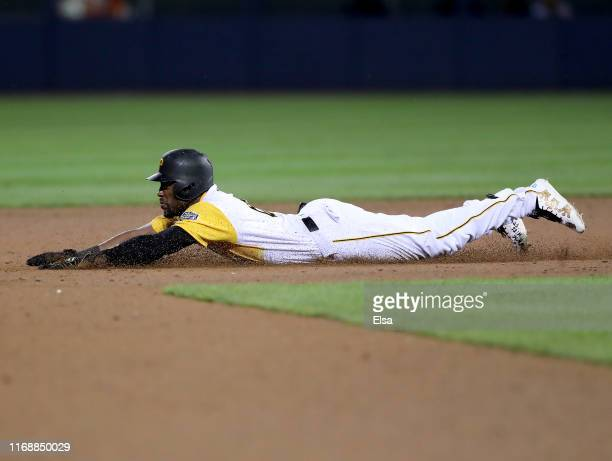 Starling Marte of the Pittsburgh Pirates steals second in the sixth inning against the Chicago Cubs during the MLB Little League Classic at Bowman...