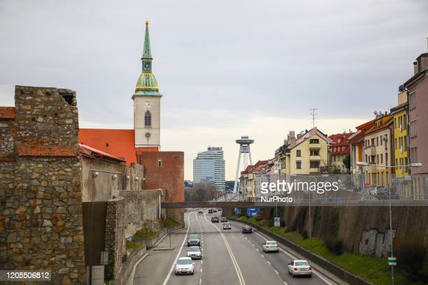 Staromestska road with traffic and St. Martins Cathedral with fortress wall in Bratislava, Slovakia, on 29th February, 2020.