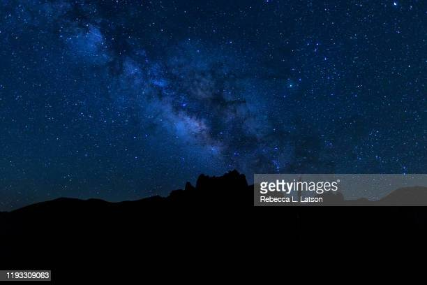 a starry morning over basin road in big bend national park - dark blue stock pictures, royalty-free photos & images