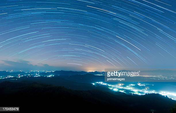 Starry night above beautiful misty mountain