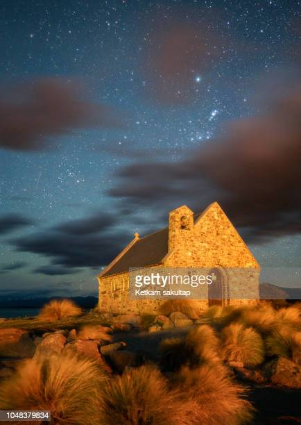 starry night at church of the good shepherd, lake tekapo, new zealand. - international landmark stock pictures, royalty-free photos & images
