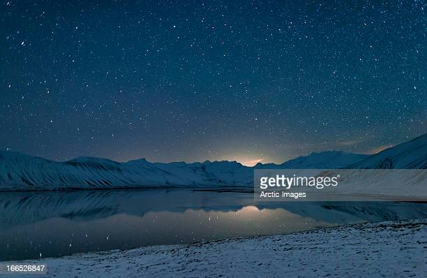 Starry night over snow covered landscape