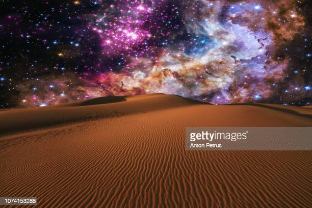 Starry night over the dunes in the desert