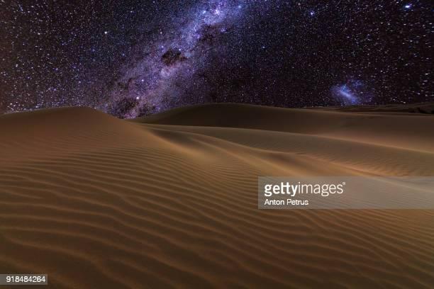 Starry night over the dunes in the desert