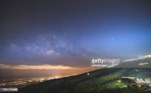 starry night over the mountain landscape of mountain with milkyway at phu thap boek moutnain, petchabun, thailand - boek stock pictures, royalty-free photos & images