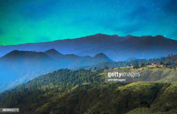 Starry night over the mountain with milky way sky at Thailand