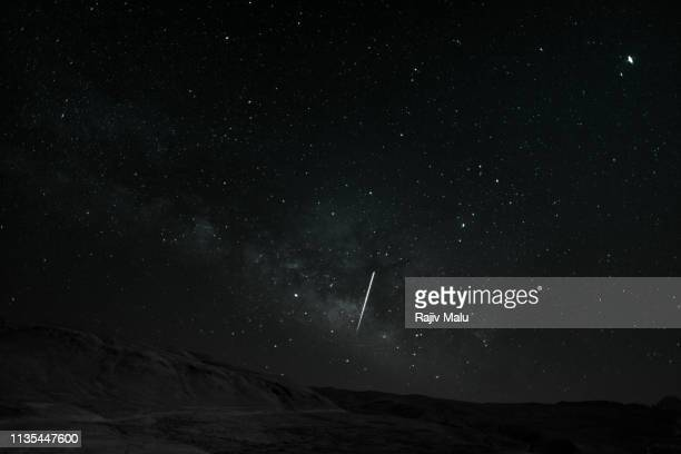 starry night - shooting star + milkyway - star trail stock pictures, royalty-free photos & images