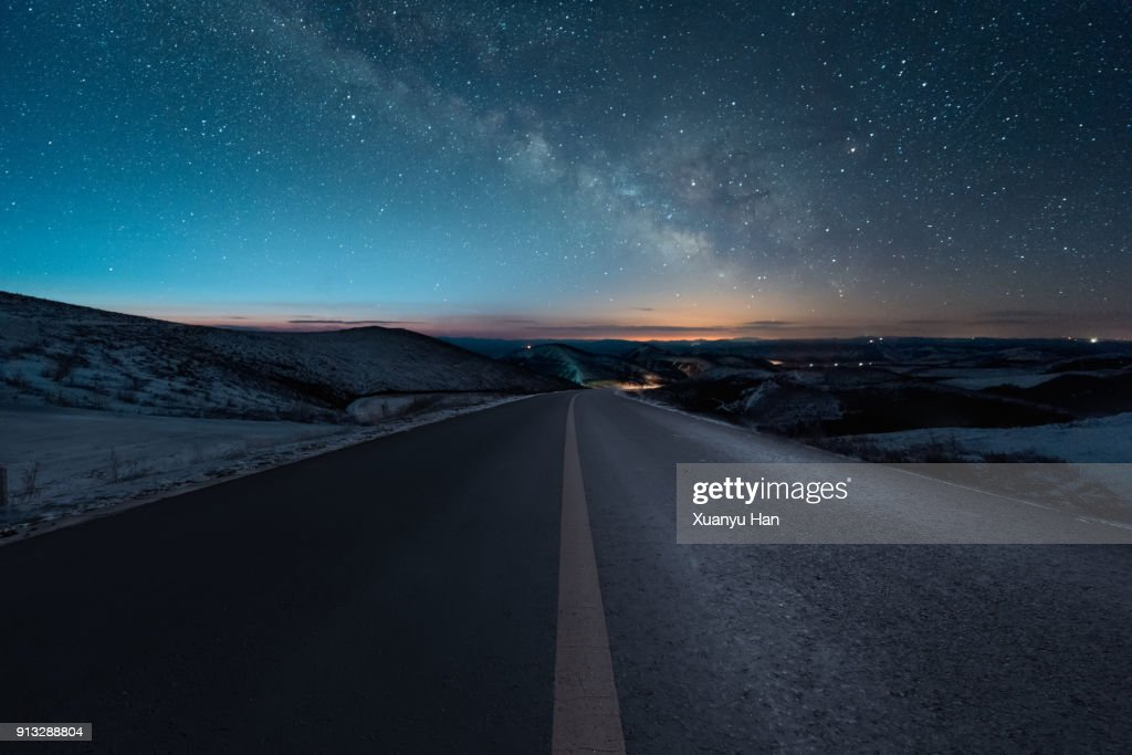Starry night with empty windy road : Stock Photo