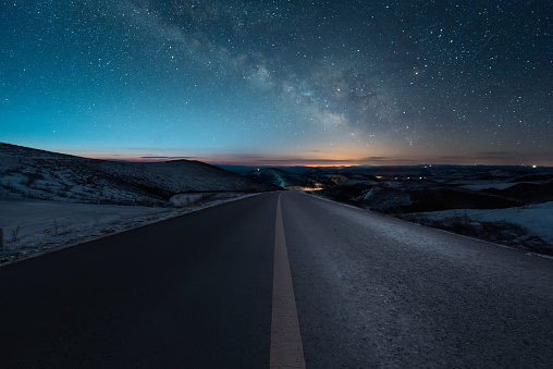 Starry night with empty windy road - gettyimageskorea