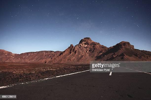 Starry sky and Road near volcano Teide at night