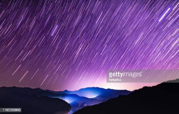 starry sky meteor shower scene - long exposure stock pictures, royalty-free photos & images