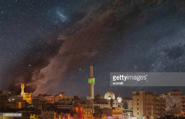 starry sky over an arabian city. - mosque stock pictures, royalty-free photos & images