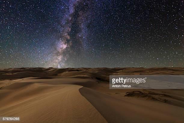 Starry Sky over the sand dunes. Gobi Desert.