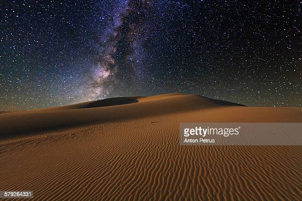 Starry Sky over the sand dunes. Gobi Desert.