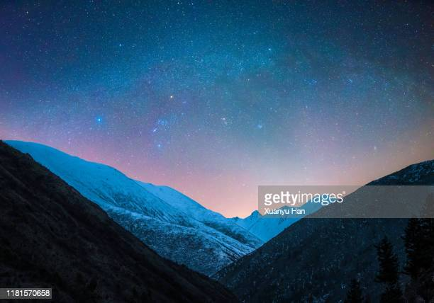 starry sky over the snowy mountains - dramatic landscape stock pictures, royalty-free photos & images