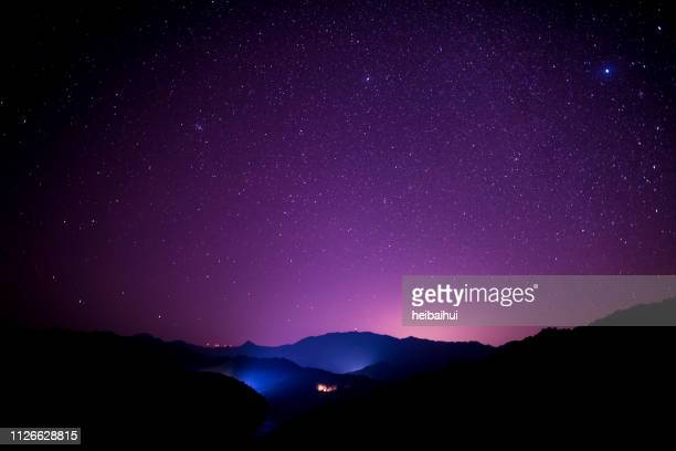 starry sky scene on high mountains, south china - purple stock pictures, royalty-free photos & images