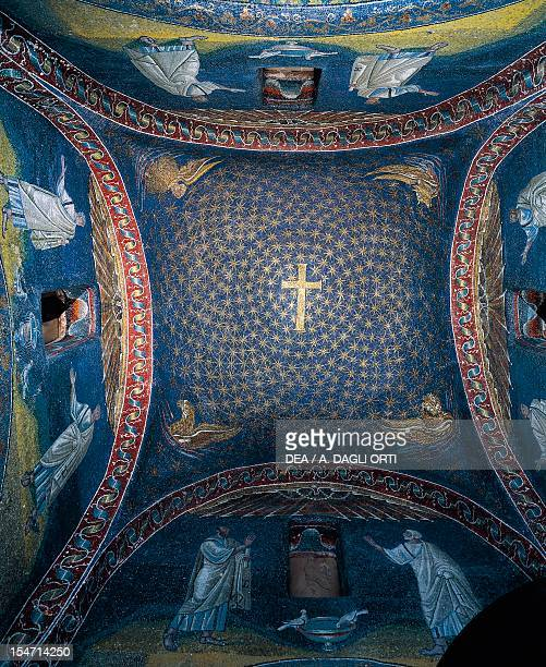Starry sky with a golden Latin cross at the zenith and four living beings the winged man lion calf eagle mosaic vault Mausoleum of Galla Placidia...
