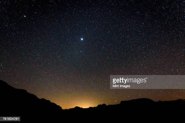 stars across the sky in the wadi rum desert wilderness in southern jordan at night. - jordan middle east stock pictures, royalty-free photos & images