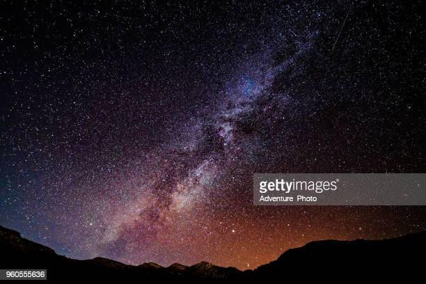 stars and milky way desert canyon landscape - star space stock pictures, royalty-free photos & images
